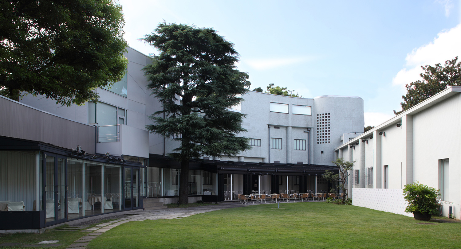 The spacious inner courtyard. The glass-walled space at the front is the café.