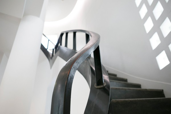 The rail on the staircase going from the second floor to the third floor. The curves of the rail have been made to give it a meandering look.
